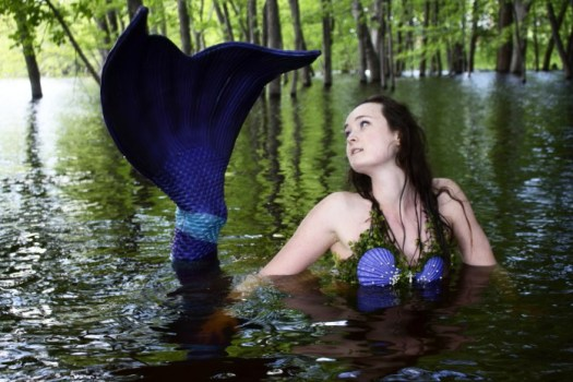 Mermaid poses in the St. Croix River.